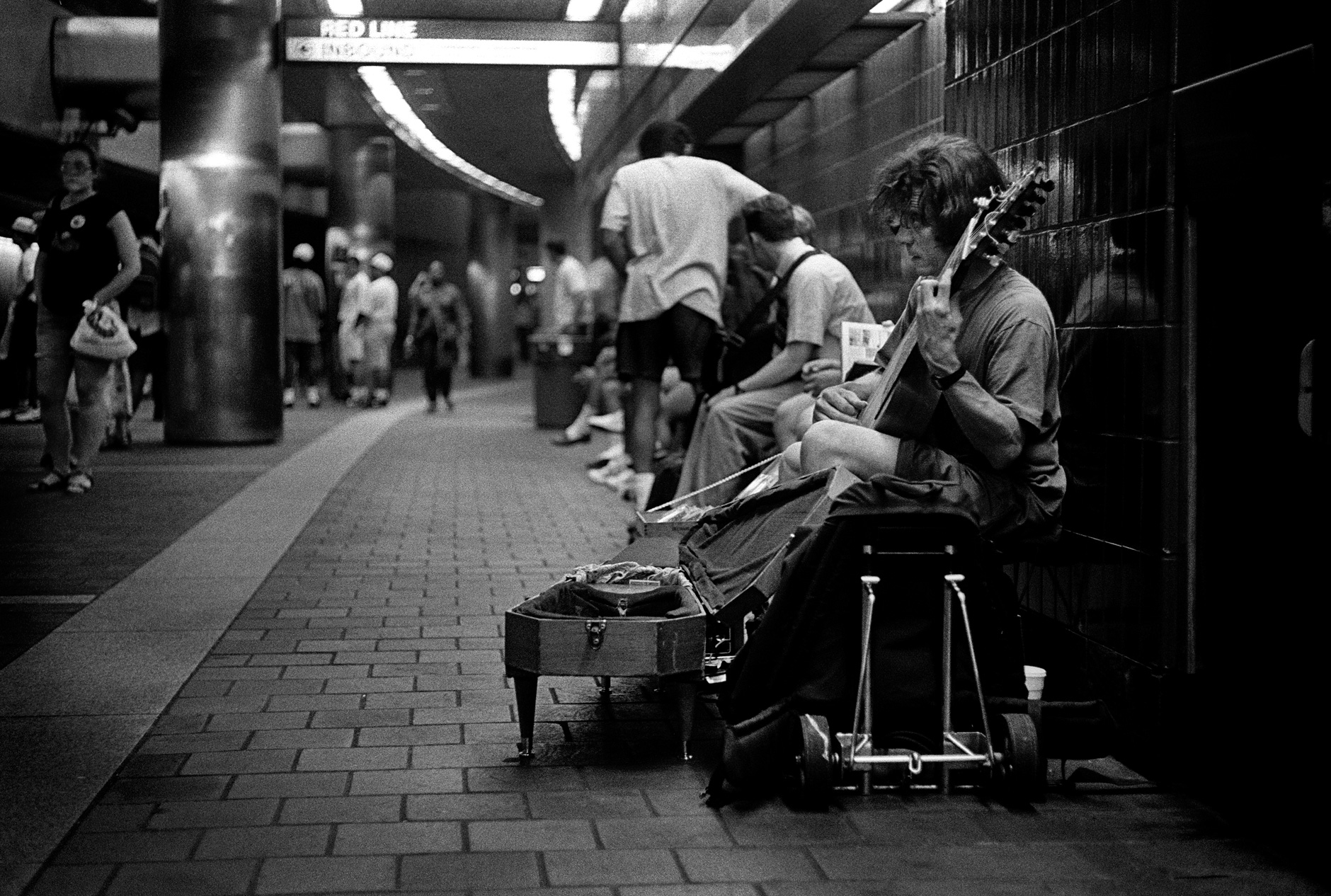people in a train station Boston, ma
