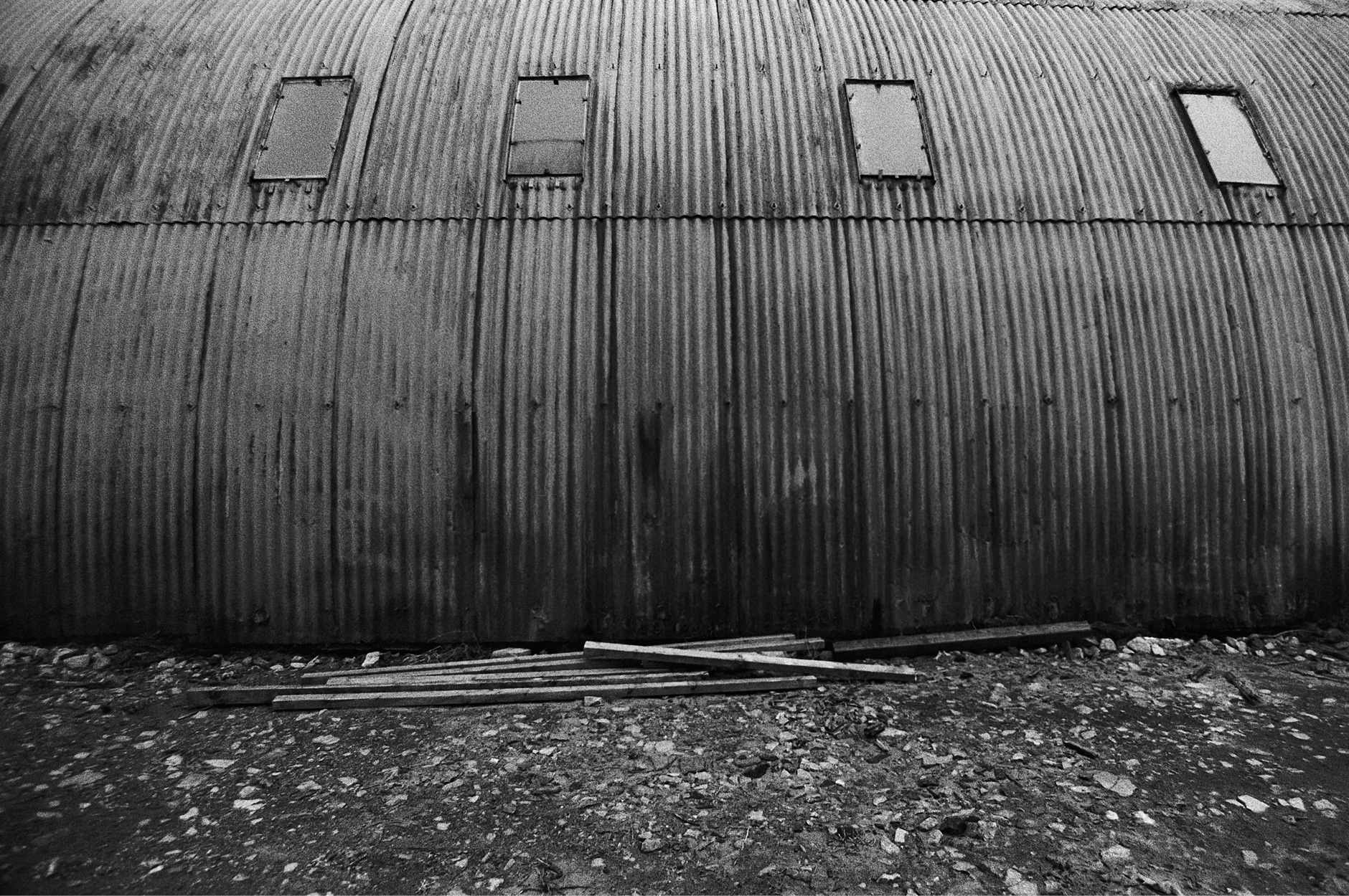 Image of hangar converted to a mechanical workshop black and white photo