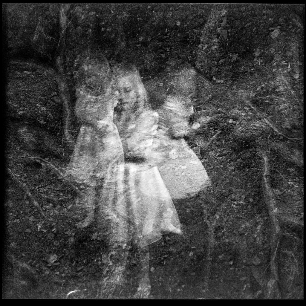 Black and white multi exposure photo of child and Forrest