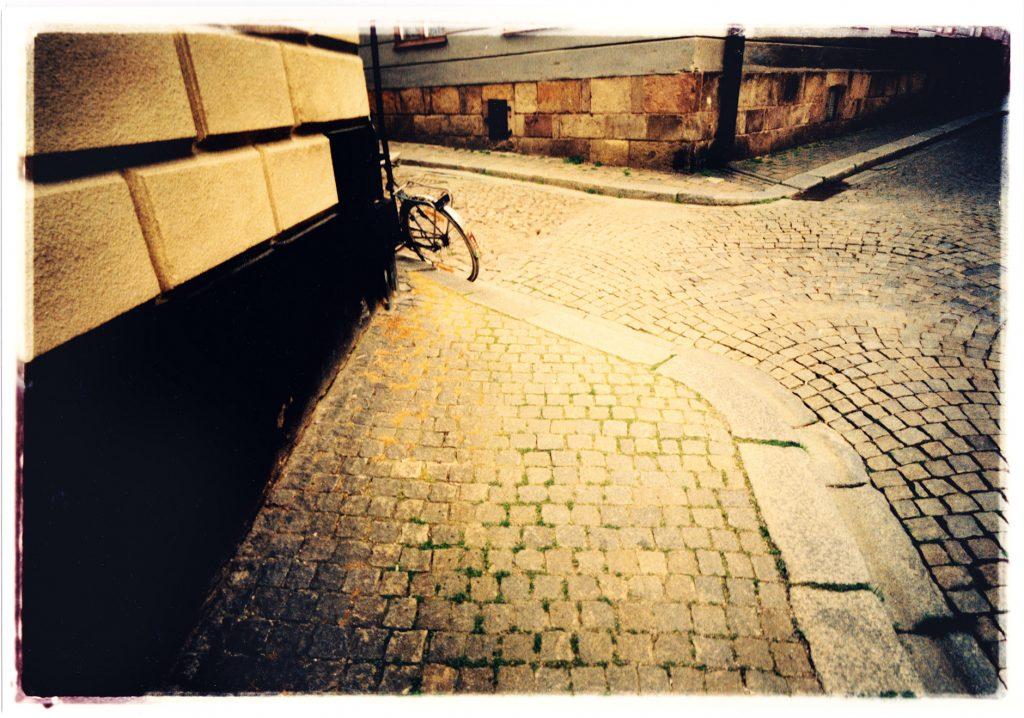 Color photo of Bike in urban surroundings
