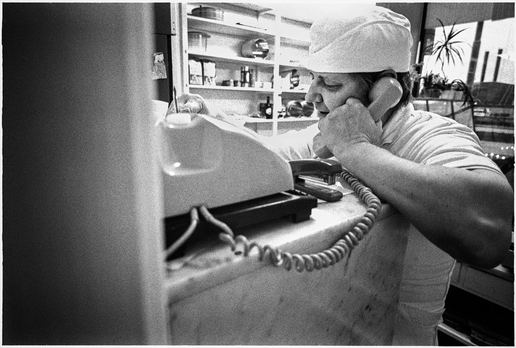 Black and white documentary picture of a baker in the store