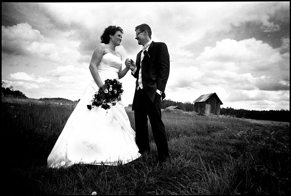 black and white wedding picture outside Wedding Sankt Anna, Sweden