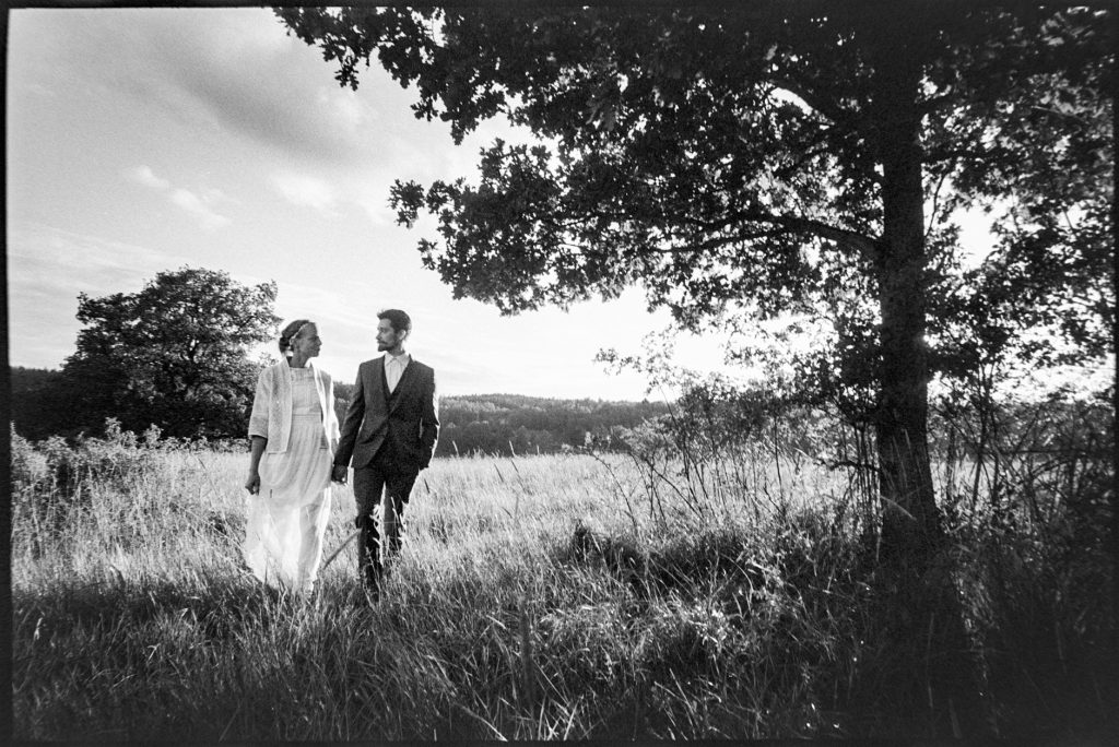 black and white wedding picture outside Wedding Skärblacka, Sweden
