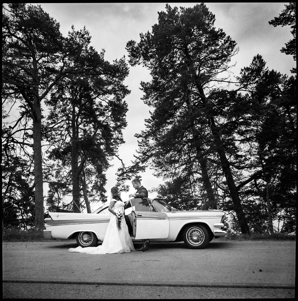 black and white wedding picture outside Wedding Krokek, Sweden