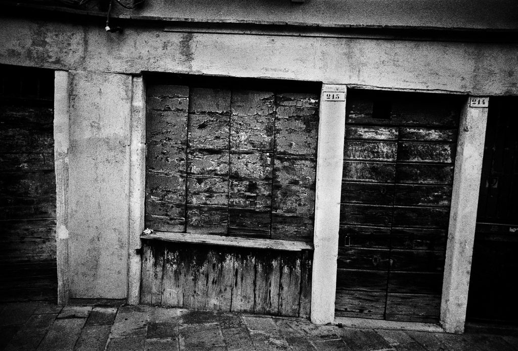 Black and white image from a street in Venice, Italy