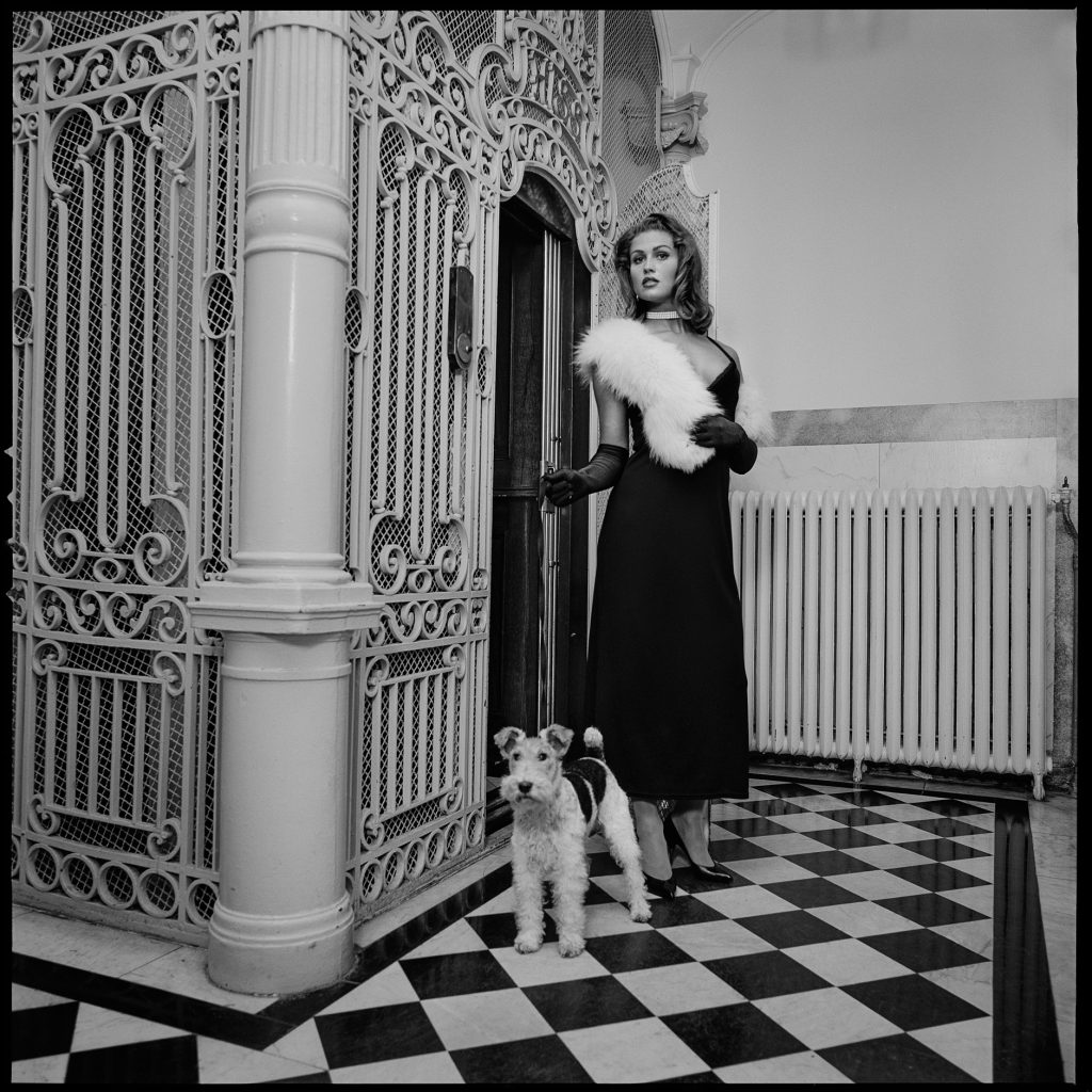 Old fashion black and white image of a lady with a dog