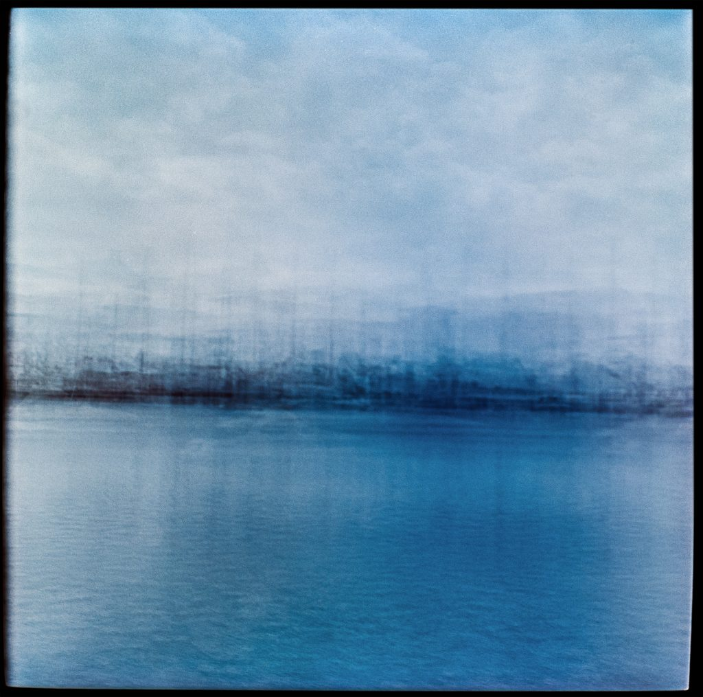Blue multiple exposure images In transit Denmark