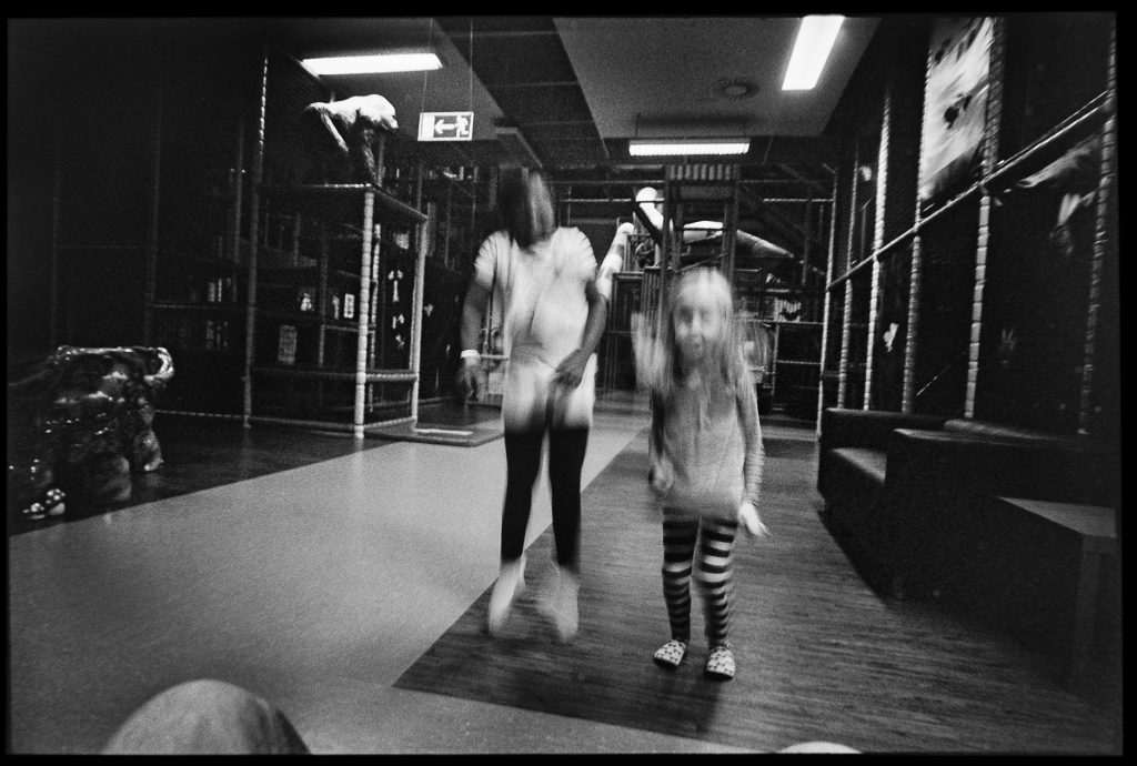 black and white image two girls playing